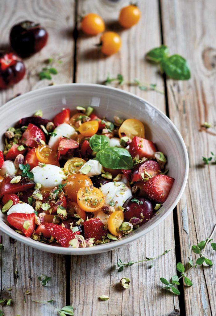 Mini mozzarella, tomato and strawberry caprese salad