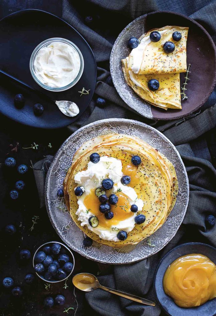 Lemon and poppy seed crêpes with cheese and lemon curd