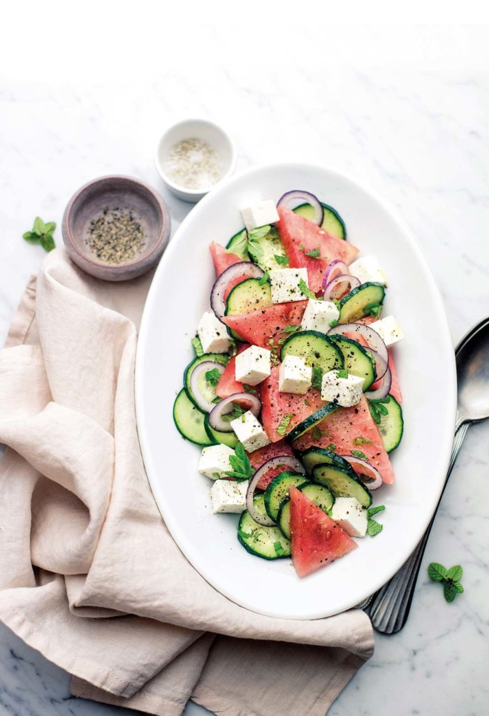 Watermelon salad with cucumbers and primosale cheese