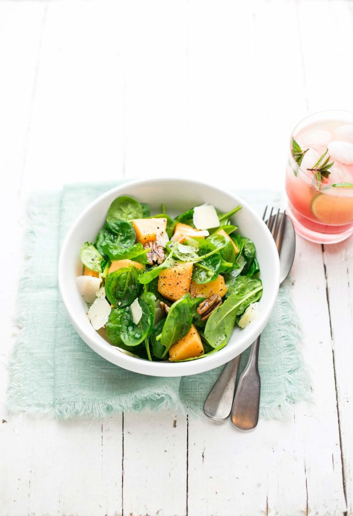 Baby spinach, melon, Parmesan cheese and pecan nut salad