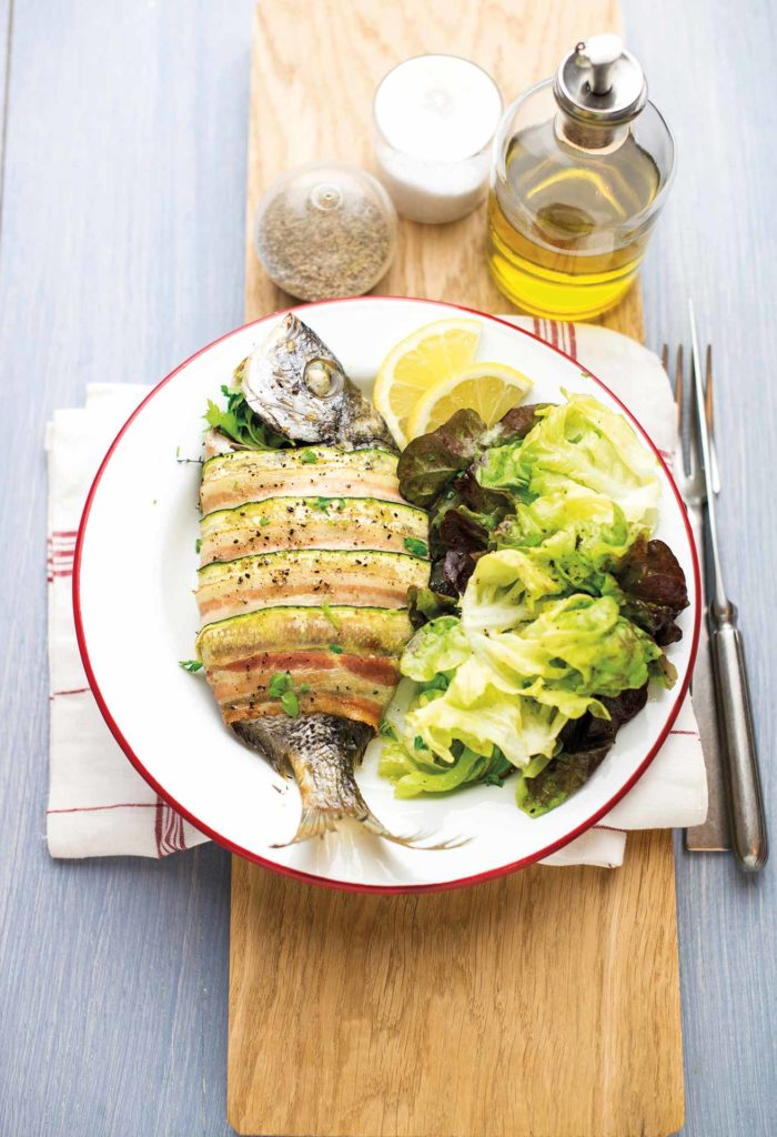 Sea bream wrapped in courgette and bacon with a mustard salad