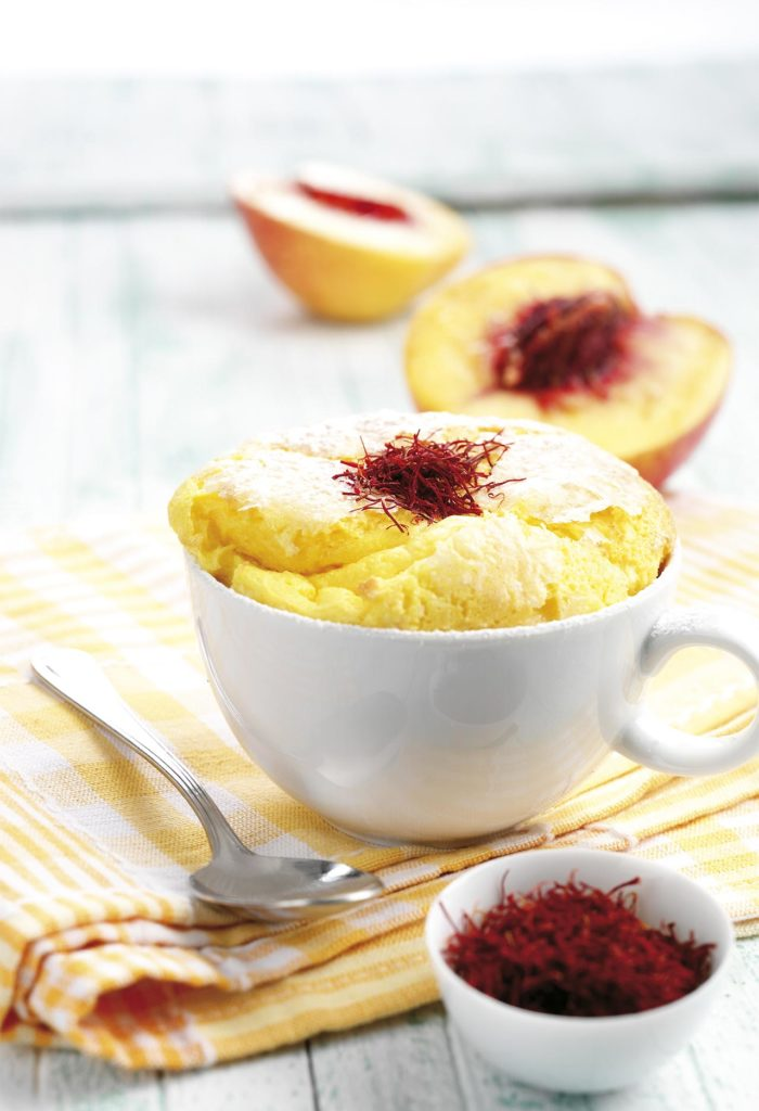 Vanilla soufflé on a bed of saffron-infused peaches
