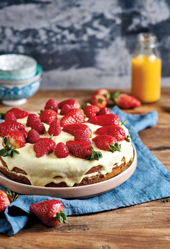 Cake with Chantilly cream, strawberries and raspberries